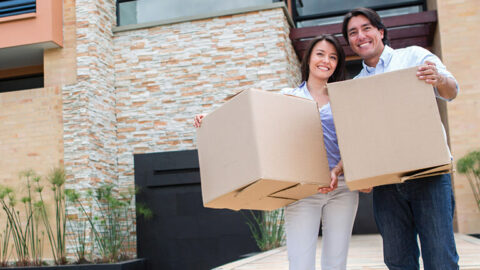 Happy couple moving into home